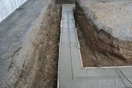 L 39 empattement de la fondation d 39 une maison - Comment couler un poteau en beton ...