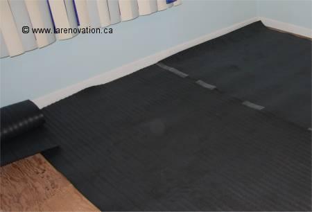 la pose de parquet flottant. Black Bedroom Furniture Sets. Home Design Ideas